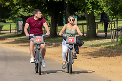 Licensed to London News Pictures. 03/09/202. London, UK. Cyclists yclist in Hyde Park, London enjoy a bit of late summer sun with mild temperatures expected today with highs of 23c. Weather forecaster have predicted a mini heatwave from Sunday for England and the South East, with temperatures hitting over 28c on Monday. Photo credit: Alex Lentati/LNP