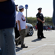 Officer Todd Waymire from the Los Angeles Police Department keeps an eye on crowds entering and leaving Dodger Stadium in game against the National League Philadelphia Phillies.