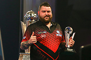 Michael Smith with runners up trophy during the 2019 William Hill World Darts Championship Final at Alexandra Palace, London, United Kingdom on 1 January 2019.
