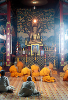 monks in a temple  in Luang Prabang, Laos, a UNESCO World Heritage Center....