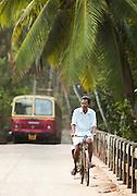 Local commuters in the morning near Kovalam and Trivandrum (Thiruvananthapuram), Kerala, India