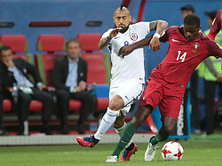 June 28, 2017 - Kazan, Russia - Arturo Vidal (L) of the Chile national football team and William Carvalho of the Portugal national football team vie for the ball during the 2017 FIFA Confederations Cup match, semi-finals between Portugal and Chile at Kazan Arena on June 28, 2017 in Kazan, Russia. (Credit Image: © Igor Russak/NurPhoto via ZUMA Press)