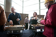 Breanne Miller, right, serves a spoonful of stuffing during the Thanksgiving meal at Energy Solutions Arena sponsored by the Salt Lake City Mission, Utah Food Services and the Utah Jazz, Tuesday, Nov. 20, 2012.