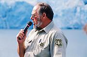 Alaska. Chugach Mountains. Park Ranger, Jim Sumner, educates visitors on Portage Glacier.