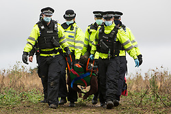 Thames Valley Police officers arrest an anti-HS2 tree protector during evictions by National Eviction Team bailiffs from a wildlife protection camp in the ancient woodland which inspired Roald Dahl's Fantastic Mr Fox at Jones' Hill Wood on 1 October 2020 in Aylesbury Vale, United Kingdom. Around 40 anti-HS2 activists and local residents, some of whom living in makeshift tree houses 60 feet above the ground, were present during the evictions at Jones' Hill Wood which had served as one of several protest camps set up along the route of the £106bn HS2 high-speed rail link in order to resist the controversial infrastructure project.
