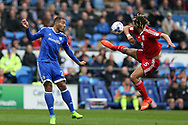 Ryan Shotton of Birmingham city ® gets to the ball ahead of Kenneth Zohore of Cardiff city.. EFL Skybet championship match, Cardiff city v Birmingham City at the Cardiff City Stadium in Cardiff, South Wales on Saturday 11th March 2017.<br /> pic by Andrew Orchard, Andrew Orchard sports photography.