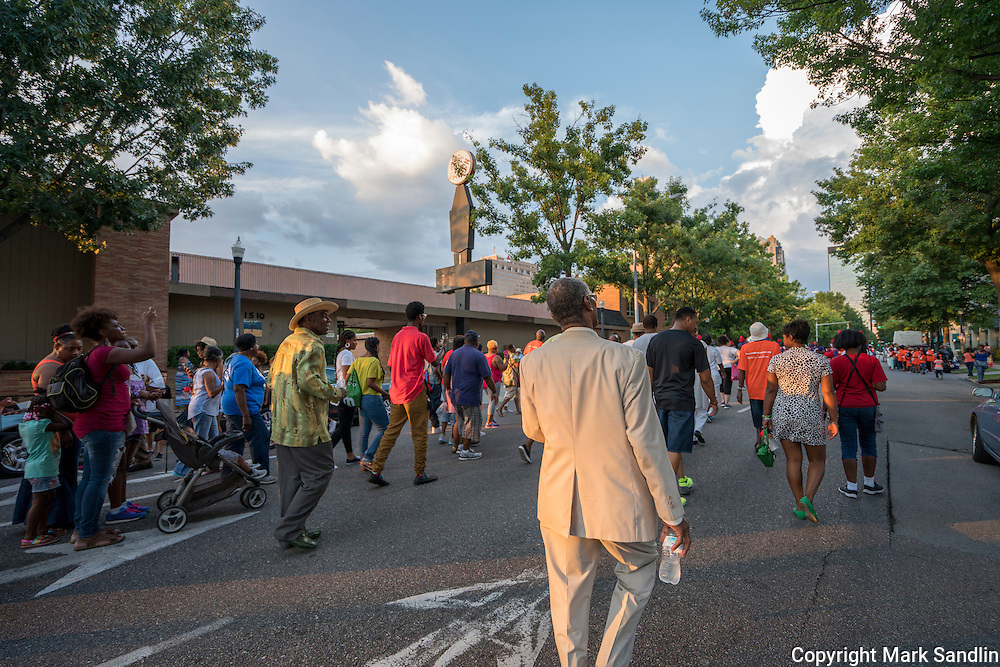 The March for Birmingham crowd starts to gather on the street outside the A. G. Gaston Motel.
