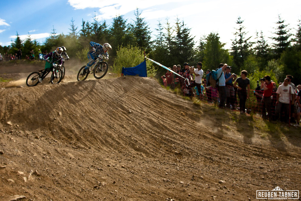 Rick Schubert (GER) cuts through the inside in the 4X at the UCI Mountain Bike World Cup in Fort William, Scotland.