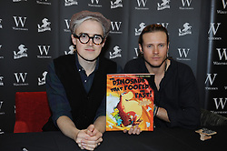 © Licensed to London News Pictures. 16/12/2014 <br /> <br /> McBusted's  Tom Fletcher and Dougie Poynter signing copies of their Dinosaur That Pooped books. The Pooping Dinosaur at Waterstones, Bluewater,Greenhithe.<br /> <br /> (Byline:Grant Falvey/LNP)