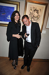 Left to right, BELLA FREUD and MATTHEW FREUD at fundraising dinner and auction in aid of Liver Good Life a charity for people with Hepatitis held at Christies, King Street, London on 16th September 2009.