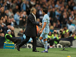 MANCHESTER, ENGLAND - Monday, April 30, 2012: Manchester City's manager Roberto Mancini and Carlos Tevez during the Premiership match against Manchester United at the City of Manchester Stadium. (Pic by Chris Brunskill/Propaganda)