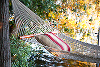 A hammock waits for a lazy afternoon by Langford Lake, near Victoria, BC Canada, a freshwater lake for swimming, relaxing and exploring for residents and visitors.