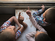 Uighur kids point to the building while approaching Yarkand. Life inside the train - mostly Muslim Uighur people  ride this train.