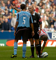 Photo. Glyn Thomas. Digitalsport<br /> West Bromwich Albion v Fulham. <br /> Barclays Premiership. 18/09/2004.<br /> Fulham captain Sylvain Legwinski (L) contests referee Dean's (C) decision to award a penalty, as Robert Earnshaw (R) prepares to take the penalty, which he missed.