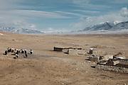 A yak caravan of Kyrgyz nomads..From Ak Chyktash (Mullah Abdul Kossim) to Ech Keli (Er Ali Boi's camp). .Trekking with yak caravan through the Little Pamir where the Afghan Kyrgyz community live all year, on the borders of China, Tajikistan and Pakistan.