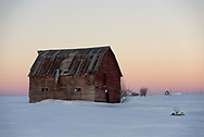 An old red barn sits along Highway 32 in Idaho