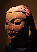Head of Shiva.  Mathura, AD400-425.  Sandstone.  This powerful head of Shiva, with ascetic's locks and the third eye of yogic insight, may have belonged to a full-length image or else to a mukhalinga, the primordial phallic form of Shiva in which the face of the god projects from its side.