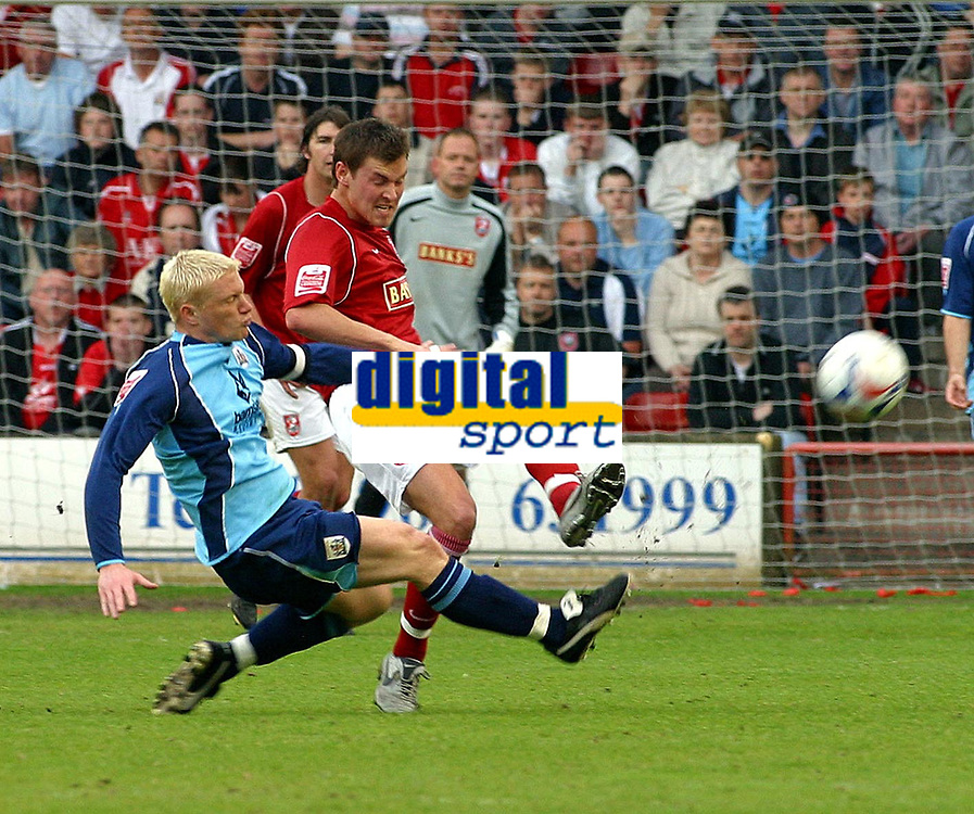 Photo: Dave Linney.<br />Walsall v Barnsley. Coca Cola League 1. 06/05/2006.Walsall's Andrew  Barrowman (R) gets to the ball first before Paul Heckingbottom