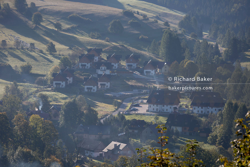 A viewpoint from a hilltop of new short-stay tourist housing for winter sports and summer walking activity visitors, on 22nd September 2019, in Jaworki, near Szczawnica, Malopolska, Poland. Local wealth has encouraged tourism apartments and short-stay properties in southern Poland mountain region, a very popular outdoor activity destination for city-dwelling Poles but at the cost of the local environment and landscape.