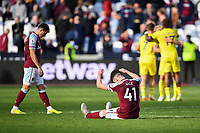 Football - 2021 / 2022  Premier League - West Ham United vs Brentford - The London Stadium - Sunday 3rd October 2021<br /> <br /> West Ham United's Declan Rice and Aaron Cresswell dejected at the final whistle.<br /> <br /> COLORSPORT/Ashley Western