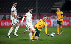 LEUVEN, BELGIUM - Wednesday, March 24, 2021: Belgium's Dries Mertens (L) is tackled by Wales' Joseff Morrell during the FIFA World Cup Qatar 2022 European Qualifying Group E game between Belgium and Wales at the King Power Den dreef Stadium. Belgium won 3-1. (Pic by Vincent Van Doornick/Isosport/Propaganda)