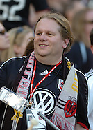 Lonnie Hovis, long time Screaming eagle and DC United fan reacts to the action on the pitch.