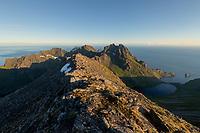 Small figue of distant hiker on summit ridge of Mengelsdalstind, Lofotodden national park, Moskenesøy, Lofoten Islands, Norway