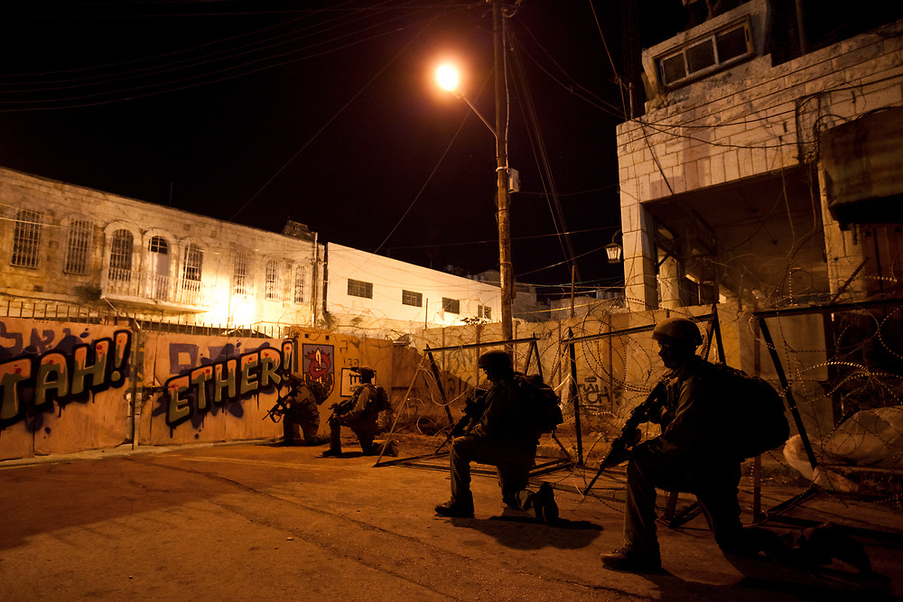 Israeli soldiers of The Paratroopers Brigade reconnaissance unit (Hebrew: 'Palsar Tzanhanim') are seen during a military operation in the West Bank city of Hebron, on September 15, 2011.