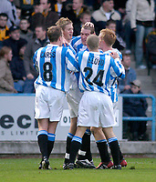 Photo. Glyn Thomas.<br /> Huddersfield Town v Hull City. Nationwide Division 3.<br /> The Alfred McAlpine Stadium, Huddersfield. 15/11/03.<br /> Huddersfield's Andrew Booth (C) is mobbed by teammates after scoring his side's second goal in the first half.