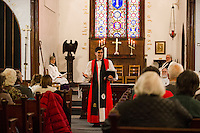 Bishop A. Robert Hirschfeld speaks to parishoners during the final service at Trinity Episcopal Church in Tilton on Sunday afternoon.  (Karen Bobotas/for the Laconia Daily Sun)