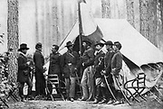 General Samuel W. Crawford, here seen with his staff, at Cedar Mountain led a charge on the left flank of the Confederate forces that came near being disastrous for Jackson. from the book ' The Civil war through the camera ' hundreds of vivid photographs actually taken in Civil war times, sixteen reproductions in color of famous war paintings. The new text history by Henry W. Elson. A. complete illustrated history of the Civil war