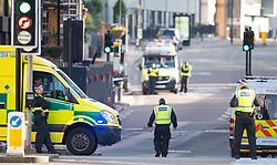 Police on Southwark Bridge Road, London, near the scene of last night's terrorist incidents in London Bridge and Borough Market.