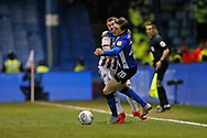 Sheffield United midfielder John Fleck (4)  and Sheffield Wednesday midfielder Adam Reach (20) contest a loose ball during the EFL Sky Bet Championship match between Sheffield Wednesday and Sheffield United at Hillsborough, Sheffield, England on 4 March 2019.