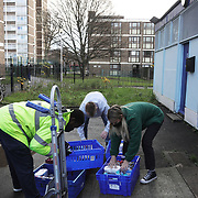 Workers and volunteers at Hackney Foodbank bank receive and organize food donations, 15th of December 2021, Hackney, East London, United Kingdom. The Hackney Foodbank is part of a nationwide network of foodbanks, supported by The Trussell Trust, working to combat poverty and hunger across the UK. The food bank gives out three days emergency food supplies to families and individual who go hungry in the borrough. The food is all donated by individuals and the food donated is held in a small ware house where it is  sorted and packed for distribution.  More people than ever in Britain have turned to the food bank for help and in Hackney the need has gone up with 350% over the past two years.