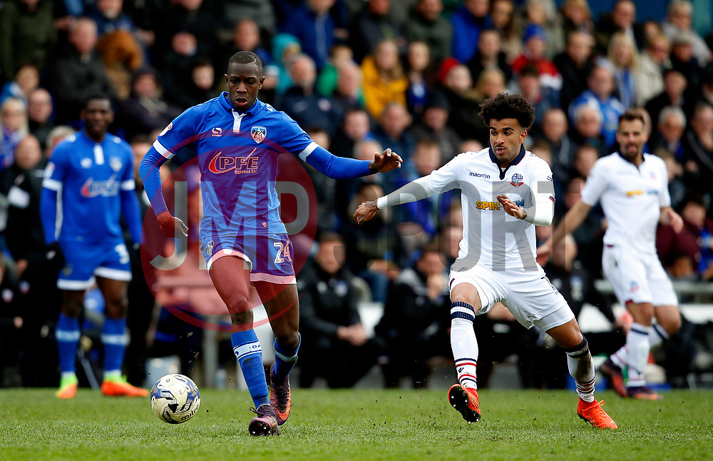 Ousmane Fane of Oldham Athletic and Derik Osede of Bolton Wanderers - Mandatory by-line: Matt McNulty/JMP - 15/04/2017 - FOOTBALL - Boundary Park - Oldham, England - Oldham Athletic v Bolton Wanderers - Sky Bet League 1