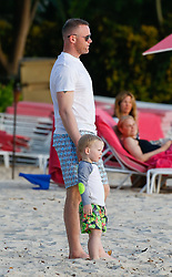 EXCLUSIVE: *NO WEB UNTIL 1200PM BST 23RD MAY* Wayne Rooney is spotted on the beach with his sons while on holiday in Barbados. 17 May 2018 Pictured: Wayne Rooney. Photo credit: MEGA TheMegaAgency.com +1 888 505 6342