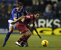 Photo: Jonathan Butler.<br />Leicester City v Cardiff City. Coca Cola Championship. 23/12/2006.<br />Gareth McAuley of Leicester is held off by Joe Ledley of Cardiff.