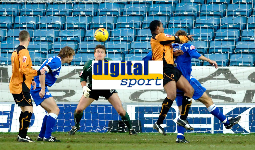 Photo: Daniel Hambury.<br />Millwall FC v Wolverhampton Wanderers. Coca Cola Championship. 21/01/2006.<br />Millwall's 'keeper Andy Marshall (C) is wide eyed as Wolves' Paul Ince (2nd, R) watches his header creep just wide.
