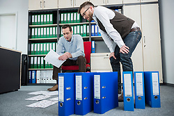 Men office stress busy sorting filing office