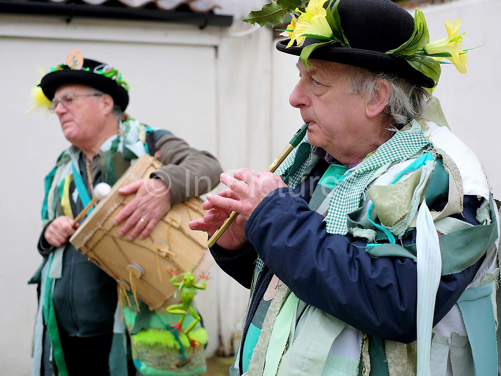 Musicians from the Makara Morris Men at an orchard-visiting wassail in Kilham village, Yorkshire Wolds, UK on 21st January 2017. Wassail is a traditional Pagan winter celebration in cider-producing regions of England, reciting incantations and singing to the trees to promote a good harvest for the coming year. Pieces of toast soaked in cider are hung in the branches to attract robins to the tree as these are said to be the good spirits of the orchard. To ward off evil spirits, villagers scare them away by banging pots and pans and making as much noise as possible