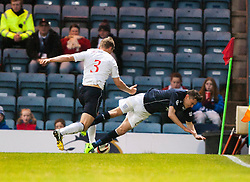 Falkirk's Stephen Kingsley pushes over Dundee's Nicolas Riley.<br /> Dundee 1 v 1 Falkirk, Scottish Championship game at Dundee's home ground Dens Park.<br /> ©Michael Schofield.