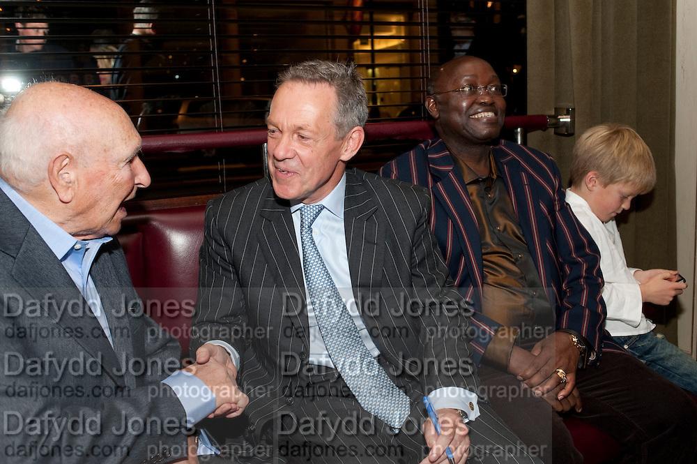 VIVIAN CRAIG; SIMON MANN; HIS LEGAL PRACTITIONER; JONATHAN SAMUKANJE ; ARTHUR MANN, Simon Mann and Marco Pierre White: Book launch for 'Cry Havoc' . Wheelers's. St. james's. London. 26 October 2011. <br /> <br />  , -DO NOT ARCHIVE-© Copyright Photograph by Dafydd Jones. 248 Clapham Rd. London SW9 0PZ. Tel 0207 820 0771. www.dafjones.com.