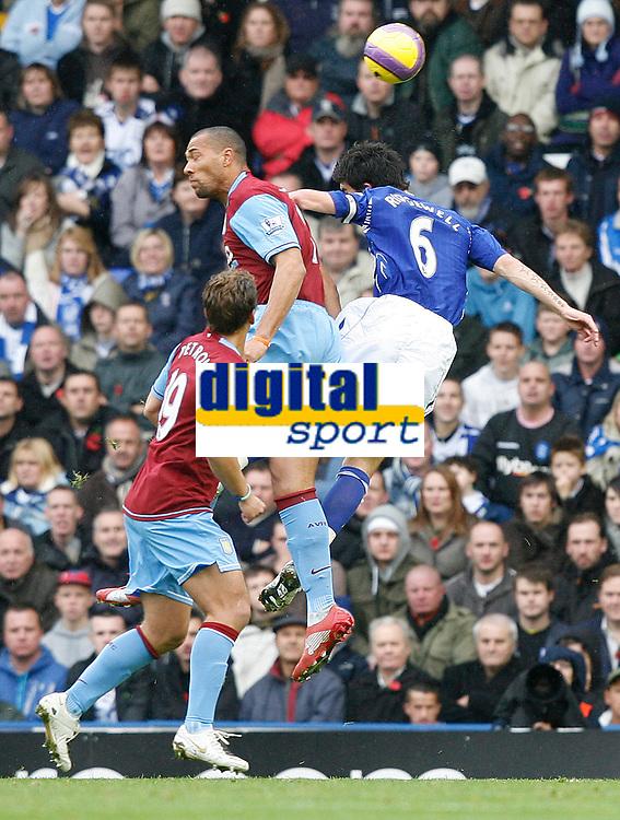 Photo: Steve Bond/Sportsbeat Images.<br /> Birmingham City v Aston Villa. The FA Barclays Premiership. 11/11/2007. John Carew (C) and Liam Ridgewell (R) contest a cross. Stiliyan Petrov (L) looks on