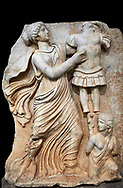Roman Sebasteion relief  sculpture of a Goddess inscribing a trophy, Aphrodisias Museum, Aphrodisias, Turkey.   Against a black background.<br /> <br /> A draped goddess strides forward to inscribe a military trophy to which is bound a kneeling female captive. The goddess is probably a personification such as Honour, Virtue or Courage. .<br /> <br /> If you prefer to buy from our ALAMY STOCK LIBRARY page at https://www.alamy.com/portfolio/paul-williams-funkystock/greco-roman-sculptures.html . Type -    Aphrodisias     - into LOWER SEARCH WITHIN GALLERY box - Refine search by adding a subject, place, background colour, museum etc.<br /> <br /> Visit our ROMAN WORLD PHOTO COLLECTIONS for more photos to download or buy as wall art prints https://funkystock.photoshelter.com/gallery-collection/The-Romans-Art-Artefacts-Antiquities-Historic-Sites-Pictures-Images/C0000r2uLJJo9_s0