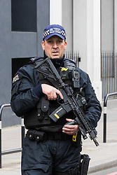 London, June 4th 2017. Armed police patrol the perimeter of the scene of the attack during a massive policing operation in the aftermath of the terrorist incident on London Bridge and Borough Market on the night of June 3rd which left seven people dead and dozens injured.