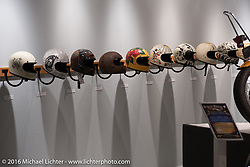 Biltwell Helmets custom painted by various artists in Michael Lichter's Skin & Bones tattoo inspired Motorcycles as Art show at the Buffalo Chip Gallery during the annual Sturgis Black Hills Motorcycle Rally.  SD, USA.  August 10, 2016.  Photography ©2016 Michael Lichter.
