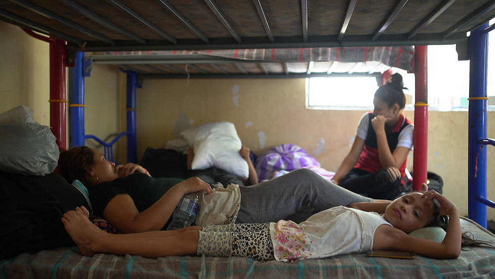 In a migrant refuge in Tapachula, Mexico, young women rest on their bunks. They have applied for permission to stay in Mexico and are waiting for response from the Mexican authorities.