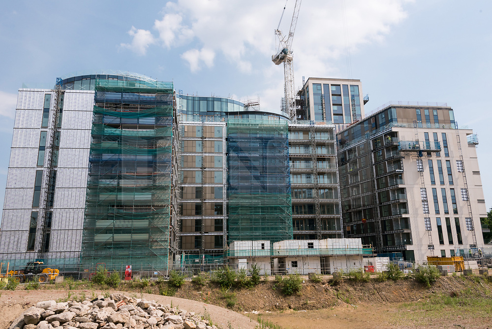 "© Licensed to London News Pictures. 21/06/2017. London, UK. Exterior view of almost finished apartment blocks in the Kensington Row complex. It was announced that sixty-eight flats will be used to house families made homeless in the Grenfell Tower fire -  for permanent occupation in July and August.  The one to four bedroom bedroom apartments sell for up to £8.5 million, will be part of the affordable quota being built and feature a more ""straightforward"" internal specification, but have the same build quality.  The City of London Corporation is acquiring the 68 flats for around £10m as part of the response to the tragedy. Photo credit: Ray Tang/LNP"