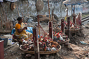A woman sells chickens at a market in the slums near the main train station in Dhaka, Bangladesh.  Nearly 20 percent of Dhaka's more than seven million residents live in the slums.