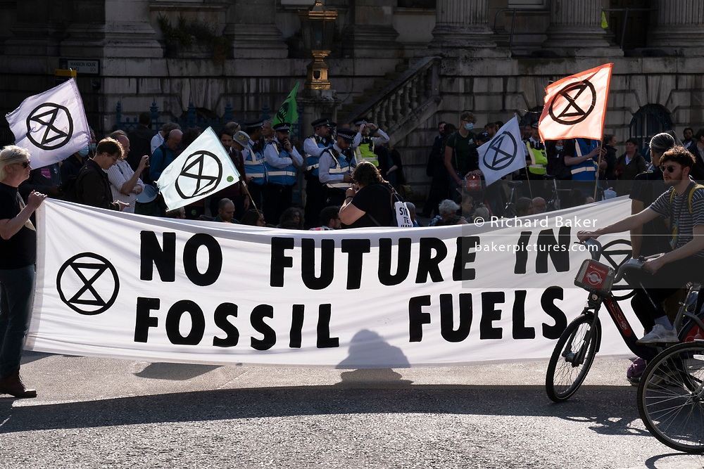 Climate Change Extinction Rebellion protesters concerened about the fossil fuel economy occupy Bank in the City of London, the capital's financial district, on 2nd September 2021, in London, England,